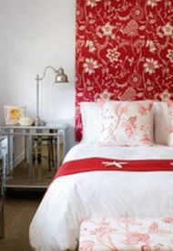 white-bedroom-with-red-accents-and-decorative-flower-pattern